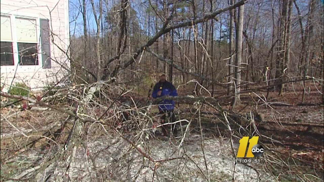 Crews work to restore power, clean up damage after an ice storm