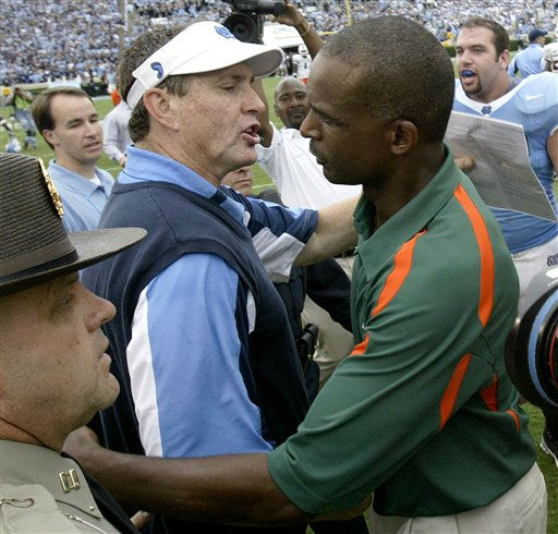 In this Oct. 6, 2007 file photo, Miami coach Randy Shannon, right, and North Carolina coach Butch Davis greet following UNC won 33-27 in an NCAA college football game in Chapel Hill, N.C.   <span class=meta>(AP Photo&#47; Gerry Broome)</span>