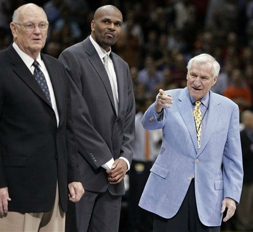 Former North coach Dean Smith, right, joins for N.C. State player Lorenzo Charles, center, and former Maryland Lefty Drizzelle oncourt during for a &#34;Legends of the ACC&#34; ceremony at the Atlantic Coast Conference basketball tournament at Bobcats Arena in Charlotte, N.C., March 15, 2008.  <span class=meta>(AP Photo)</span>
