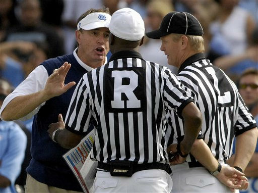 North Carolina coach Butch Davis discusses a call with referee Ron Cherry and linesman Troy Gray, right, during an NCAA college football game against Virginia Tech on Saturday, Sept. 20, 2008, in Chapel Hill, N.C. Virginia Tech won 20-17.  <span class=meta>(AP Photo&#47; SARA DAVIS)</span>