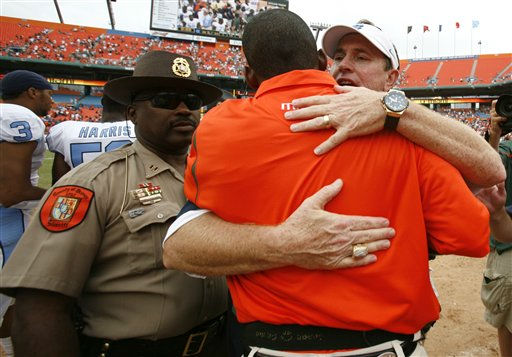 "<div class=""meta image-caption""><div class=""origin-logo origin-image ""><span></span></div><span class=""caption-text"">North Carolina head coach Butch Davis, right, hugs Miami  head coach Randy Shannon after North Carolina beat Miami 28-24 in an NCAA college football at Dolphin Stadium in Miami Saturday, Sept. 27, 2008.   (AP Photo/ Lynne Sladky)</span></div>"