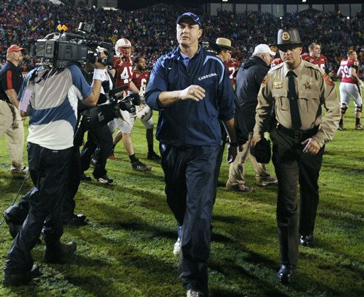 "<div class=""meta ""><span class=""caption-text "">North Carolina head coach Butch Davis, center, leaves the field after his team was defeated 17-15 by Maryland in an NCAA college football game, Saturday, Nov. 15, 2008, in College Park, Md.  (AP Photo/ Nick Wass)</span></div>"