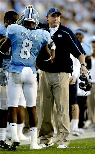 North Carolina coach Butch Davis congratulates Greg Little &#40;8&#41; following Little&#39;s touchdown against Miami during the first half of an NCAA college football game in Chapel Hill, N.C., Saturday, Nov. 14, 2009. North Carolina won 33-24.  <span class=meta>(AP Photo&#47; Gerry Broome)</span>