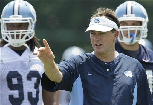 In this Friday, Aug. 6, 2010 photo, North Carolina football coach Butch Davis coaches his team during training camp in Chapel Hill, N.C.  <span class=meta>(AP Photo&#47; Gerry Broome)</span>