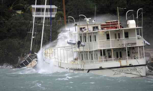 A boat is battered by waves in Sopers Hole during the passage of Hurricane Earl near Tortola, British Virgin Islands, Monday Aug. 30, 2010. (AP Photo/Todd VanSickle)