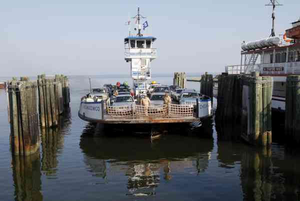 A ferry with cars traveling from Ocracoke Island docks in Hatteras, N.C., Wednesday, Sept. 1, 2010.  (AP Photo/Gerry Broome)