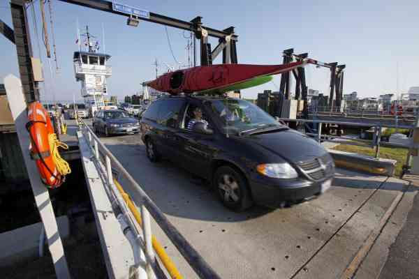 Cars leaving Ocracoke on a ferry Island arrive in Hatteras, N.C., Wednesday, Sept. 1, 2010. (AP Photo/Gerry Broome)