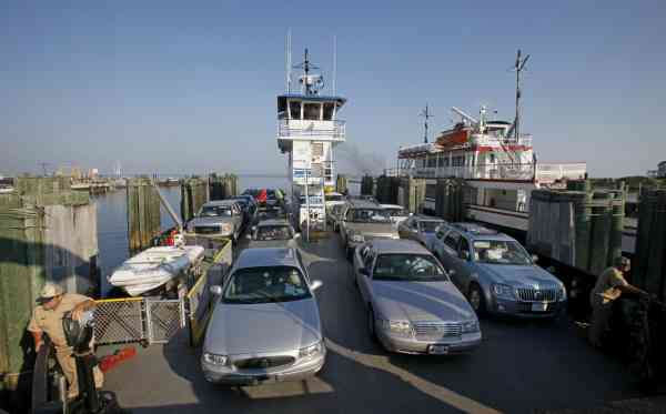 "<div class=""meta ""><span class=""caption-text "">A ferry with cars traveling from Ocracoke Island docks in Hatteras, N.C., Wednesday, Sept. 1, 2010.  (AP Photo/Gerry Broome)</span></div>"