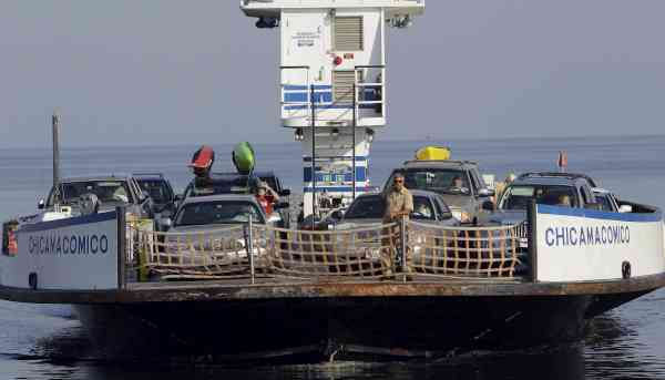 A ferry with cars from Ocracoke Island docks in Hatteras, N.C., Wednesday, Sept. 1, 2010. (AP Photo/Gerry Broome)