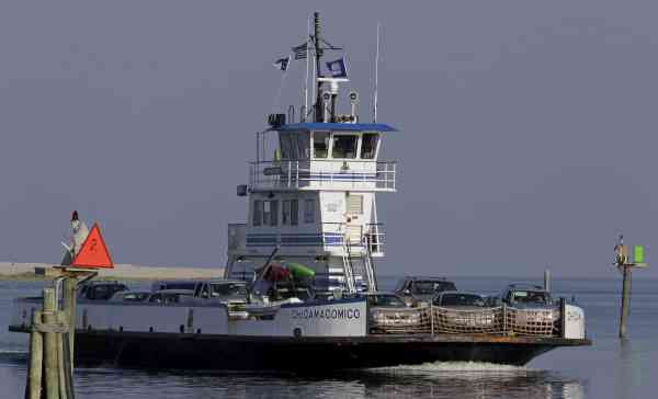 A ferry full of cars from Ocracoke Island  arrives to dock in Hatteras, N.C., Wednesday, Sept. 1, 2010. (AP Photo/Gerry Broome)