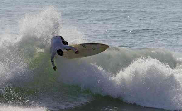 A surfer rides the waves as Hurricane Earl aproaches in Buxton, N.C., Wednesday, Sept. 1, 2010.  (AP Photo/Gerry Broome)