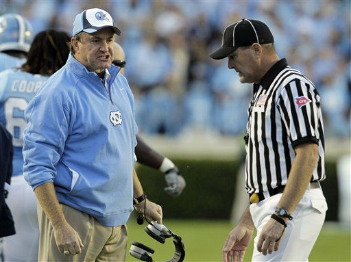 North Carolina coach Butch Davis argues with an official during the first half of an NCAA college football game against Virginia Tech in Chapel Hill, N.C., Saturday, Nov. 13, 2010. Virginia Tech won 26-10.  <span class=meta>(AP Photo&#47; Gerry Broome)</span>