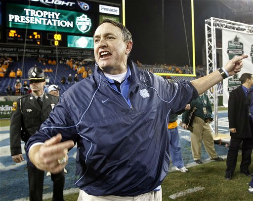 North Carolina head coach Butch Davis calls his players over for the trophy presentation after  defeating Tennessee 30-27 in double overtime in the Music City Bowl NCAA college football game on Thursday, Dec. 30, 2010, in Nashville, Tenn.  <span class=meta>(AP Photo&#47; Mark Humphrey)</span>