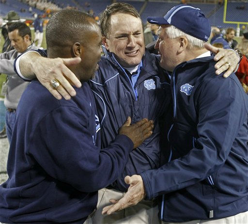 North Carolina coach Butch Davis, center, celebrates with members of his staff after North Carolina beat Tennessee 30-27 in two overtimes in the Music City Bowl NCAA college football game on Thursday, Dec. 30, 2010, in Nashville, Tenn.  <span class=meta>(AP Photo&#47; Mark Humphrey)</span>