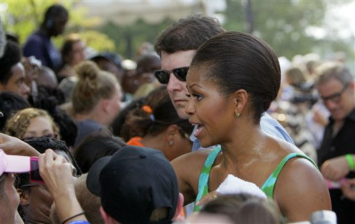 "<div class=""meta ""><span class=""caption-text "">First lady Michelle Obama works the crowd while participating during the taping of Extreme Makeover Home Edition in Fayetteville, N.C., Thursday, July 21, 2011.  (AP Photo/ Gerry Broome)</span></div>"