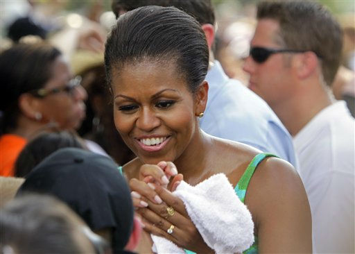 First lady Michelle Obama greets onlookers while she participates during the taping of Extreme Makeover Home Edition in Fayetteville, N.C., Thursday, July 21, 2011.  <span class=meta>(AP Photo&#47; Gerry Broome)</span>