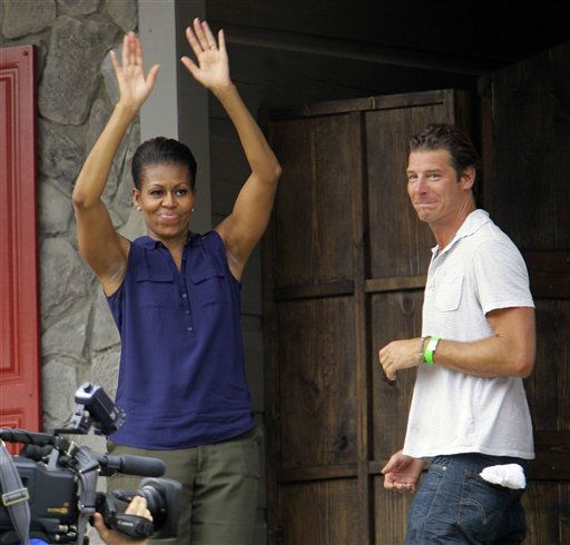 First lady Michelle Obama waves as she and Ty Pennington, host of Extreme Makeover Home Edition, enter the Jubilee House during the taping of an episode in Fayetteville, N.C., Thursday, July 21, 2011.  <span class=meta>(AP Photo&#47; Gerry Broome)</span>