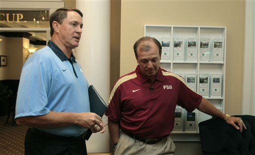 In this photo taken Monday, July 25, 2011, North Carolina coach Butch Davis, left, speaks with Florida State coach Jimbo Fisher during the Atlantic Coast Conference Football Kickoff in Pinehurst, N.C. University of North Carolina Chancellor Holden Thorp announced Wednesday, July 27, 2011, that Davis has been dismissed as head coach of the football program.   <span class=meta>(AP Photo&#47; Gerry Broome)</span>