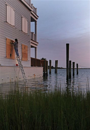 Lasarro Perez covers windows in a building with plywood in Beaufort, N.C., Thursday, Aug. 25, 2011 as Hurricane Irene heads toward the North Carolina coast. <span class=meta>(AP Photo&#47; Chuck Burton)</span>