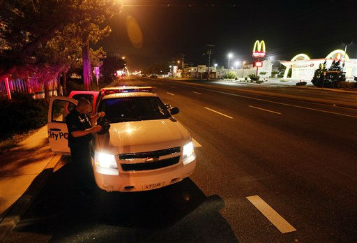 "<div class=""meta image-caption""><div class=""origin-logo origin-image ""><span></span></div><span class=""caption-text"">Sgt. Mark Paddack with the Ocean City Police Department stands outside his cruiser on a deserted Philadelphia Avenue while on patrol in Ocean City, Md., Friday, Aug. 26, 2011. Forecasters expect hurricane force winds in Ocean City, which is under a mandatory evacuation order, by late Saturday.  (AP Photo/ Patrick Semansky)</span></div>"