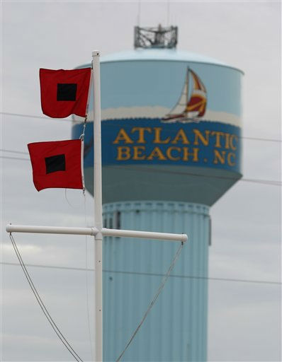 "<div class=""meta ""><span class=""caption-text "">Hurricane warning flags fly in Atlantic Beach, N.C., Friday, Aug. 26, 2011, as Hurricane Irene heads toward the North Carolina coast.  (AP Photo/ Chuck Burton)</span></div>"