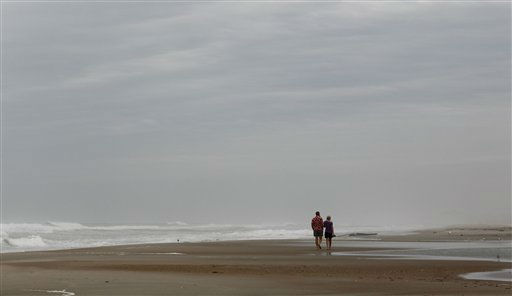 A couple walks along an empty stretch of beach in Atlantic Beach, N.C., Friday, Aug. 26, 2011 as Hurricane Irene heads toward the North Carolina coast.  <span class=meta>(AP Photo&#47; Chuck Burton)</span>