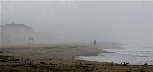 "<div class=""meta image-caption""><div class=""origin-logo origin-image ""><span></span></div><span class=""caption-text"">A lone beachgoer is seen in Nags Head, N.C., Friday, Aug. 26, 2011 after evacuations in preparation for Hurricane Irene have left the area mostly deserted. The full force of Hurricane Irene was still a day away from the East Coast but heightened waves began hitting North Carolina's Outer Banks early Friday.   (AP Photo/ Gerry Broome)</span></div>"
