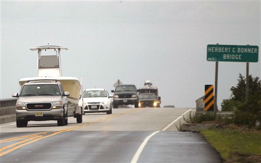"<div class=""meta ""><span class=""caption-text "">With mandatory evacuations for visitors and residents in place before the arrival of Hurricane Irene, motorists, some towing boats, drive north as they cross the Bonner Bridge leaving Hatteras Island in Nags Head, N.C., Friday, Aug. 26, 2011 on North Carolina's Outer Banks.  (AP Photo/ Charles Dharapak)</span></div>"