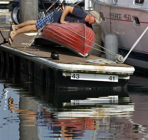 Charlie Norman secures his rowboat at Anchorage Marina before the arrival of Hurricane Irene, Friday, Aug. 26, 2011, in Baltimore.  <span class=meta>(AP Photo&#47; Alex Brandon)</span>