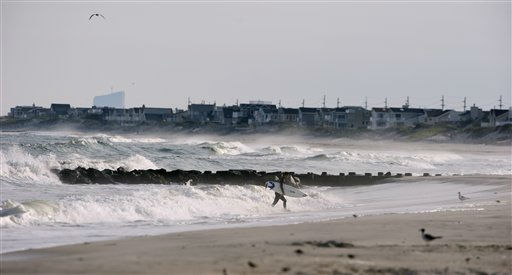 A surfer walks out of the Atlantic Ocean after riding the waves while other residents were preparing for the arrival of Hurricane Irene, Friday Aug. 26, 2011 in Beach Haven, N.J.  Numerous residents and visitors remain on Long Beach Island even though a mandatory evacuation order has been issued by Governor Christie.  <span class=meta>(AP Photo&#47; Joe Epstein)</span>