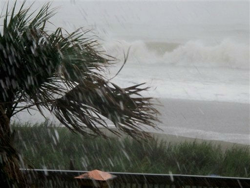"<div class=""meta ""><span class=""caption-text "">Rains and waves from Hurricane Irene batter the shore in downtown Myrtle Beach, S.C., on Friday, Aug. 26, 2011.  Irene has the potential to cause billions of dollars in damage all along a densely populated arc that includes Washington, Baltimore, Philadelphia, New York, Boston and beyond. At least 65 million people could be affected. (AP Photo/ Bruce Smith)</span></div>"