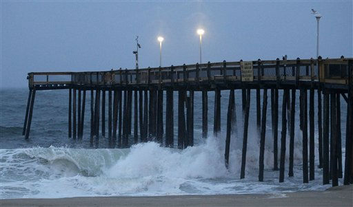 Waves crash against a pier in Ocean City, Md., Saturday, Aug. 27, 2011, as Hurricane Irene heads toward the Maryland coast. <span class=meta>(AP Photo&#47; Patrick Semansky)</span>