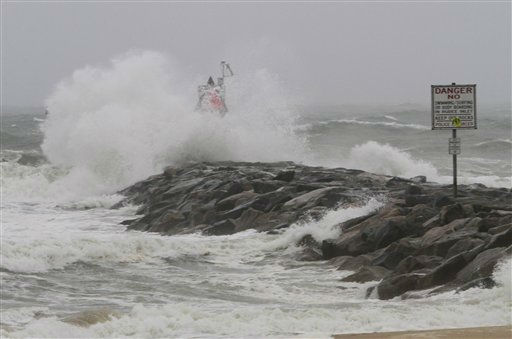 Waves and wind from Hurricane Irene pound the Rudee inlet jetty in Virginia Beach , Va., Saturday, Aug. 27, 2011. <span class=meta>(AP Photo&#47; Steve Helber)</span>