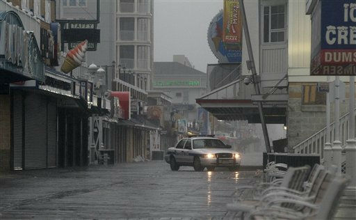 "<div class=""meta ""><span class=""caption-text "">An Ocean City Police Department cruiser  patrols a boardwalk in Ocean City, Md., Saturday, Aug. 27, 2011, as Hurricane Irene heads toward the Maryland coast.  (AP Photo/ Patrick Semansky)</span></div>"