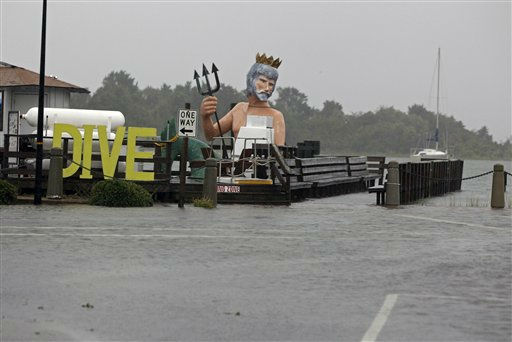 Floodwaters cover the street and the entrance to a dive shop in downtown Morehead City, N.C., Saturday, Aug. 27, 2011 as Hurricane Irene hits the North Carolina coast. <span class=meta>(AP Photo&#47; Chuck Burton)</span>