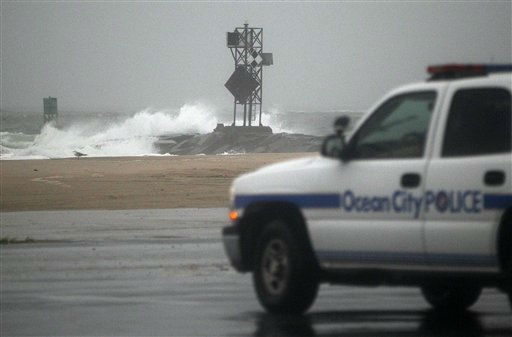 An Ocean City Police Department cruiser stands watch near a beach in Ocean City, Md., Saturday, Aug. 27, 2011, as Hurricane Irene heads toward the Maryland coast.  <span class=meta>(AP Photo&#47; Patrick Semansky)</span>