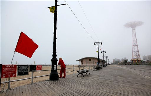 "<div class=""meta ""><span class=""caption-text "">A red-flagged beach greets visitors to the Coney Island boardwalk as people await the arrival of Hurricane Irene at the Coney Island section of New York, Saturday, Aug. 27 2011.  (AP Photo/ Craig Ruttle)</span></div>"