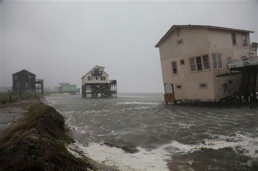 Abandoned beach front houses are surrounded by rising water as the effects of Hurricane Irene are felt in Nags Head, N.C., Saturday, Aug. 27, 2011   <span class=meta>(AP Photo&#47; Gerry Broome)</span>