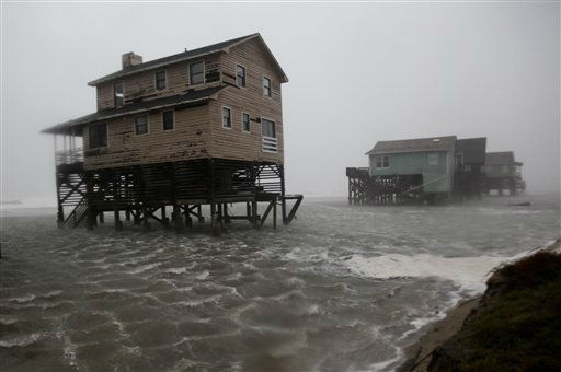 "<div class=""meta ""><span class=""caption-text "">Abandoned beach front houses are surrounded by rising water as the effects of Hurricane Irene are felt in Nags Head, N.C., Saturday, Aug. 27, 2011   (AP Photo/ Gerry Broome)</span></div>"
