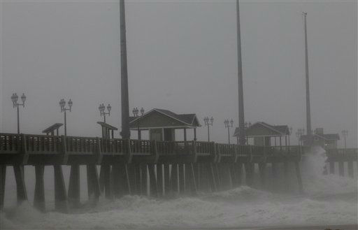 "<div class=""meta ""><span class=""caption-text "">Waves crash on Jennette's Pier as the effects of Hurricane Irene are felt in Nags Head, N.C., Saturday, Aug. 27, 2011   (AP Photo/ Gerry Broome)</span></div>"