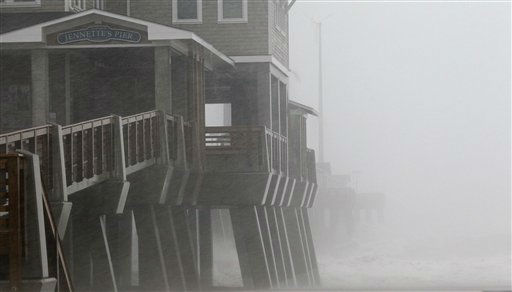 Waves and driving rain lash Jennette&#39;s Pier as the effects of Hurricane Irene are felt in Nags Head, N.C., Saturday, Aug. 27, 2011 <span class=meta>(AP Photo&#47; Gerry Broome)</span>