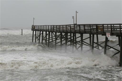 Waves crash against a damaged pier in Atlantic Beach, N.C., Saturday, Aug. 27, 2011 as Hurricane Irene hits the North Carolina coast.  <span class=meta>(AP Photo&#47; Chuck Burton)</span>