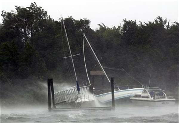 Boats are bashed against the shore and a dock in Morehead City, N.C., Saturday, Aug. 27, 2011 as Hurricane Irene hits the North Carolina coast.  <span class=meta>(&#40;AP Photo&#47;Chuck Burton&#41;)</span>