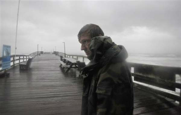 Denis Hromin, a fisherman, checks on a fishing pier on the Outer Banks in Kill Devil Hills, N.C., Saturday, Aug. 27, 2011. Hurricane Irene knocked out power and piers in North Carolina, clobbered Virginia with wind, and churned up the coast Saturday to confront cities more accustomed to snowstorms than tropical storms. <span class=meta>( &#40;AP Photo&#47;Charles Dharapak&#41;)</span>