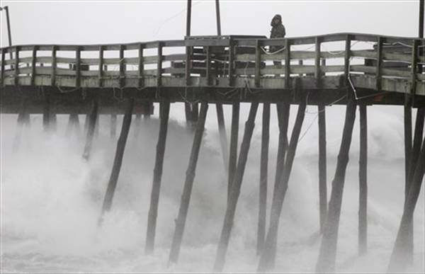 Denis Hromin, a concerned fisherman, checks on Avalon Fishing Pier as it lost some pilings after being battered by wind and waves on the Outer Banks in Kill Devil Hills, N.C., Saturday, Aug. 27, 2011 as Hurricane Irene reaches the North Carolina coast.  <span class=meta>(&#40;AP Photo&#47;Charles Dharapak&#41;)</span>