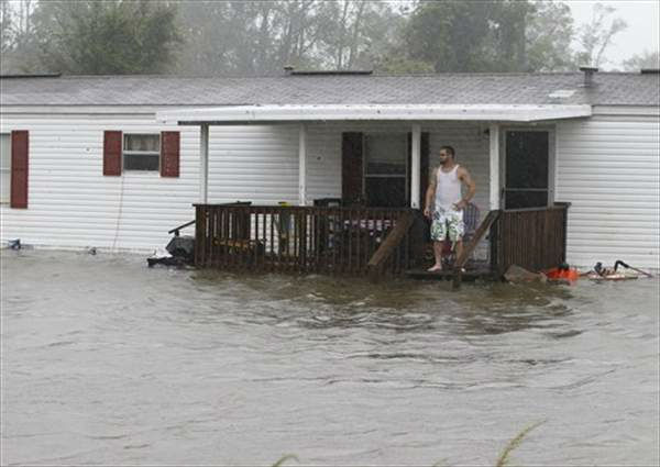 "<div class=""meta ""><span class=""caption-text "">Jarod Wilton looks at the flood waters rising to his doorstep, Saturday, Aug. 27, 2011, in Alliance, N.C., as Hurricane Irene hits the North Carolina coast.  ((AP Photo/Chuck Burton))</span></div>"
