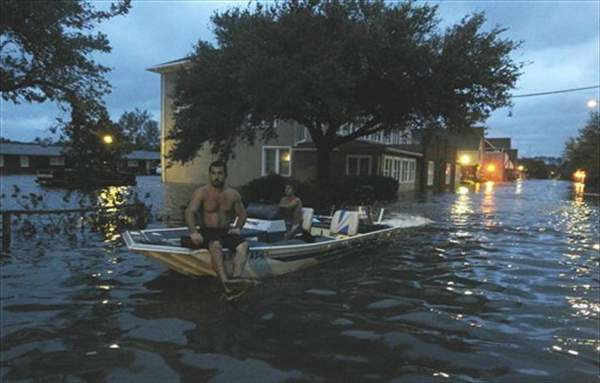 Two men use a boat to explore a street flooded by Hurricane Irene Saturday, Aug. 27, 2011 in Manteo, N.C.  <span class=meta>(&#40;AP Photo&#47;John Bazemore&#41;)</span>