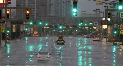 "<div class=""meta ""><span class=""caption-text "">The  Holland Tunnel is seen nearly deserted as rain from the outer bands of Hurricane Irene soak up the area, Saturday, Aug. 27, 2011 in Jersey City, N.J. Hurricane Irene knocked out power and piers in North Carolina, clobbered Virginia with wind and churned up the coast Saturday to confront cities more accustomed to snowstorms than tropical storms. (AP Photo/ Julio Cortez)</span></div>"