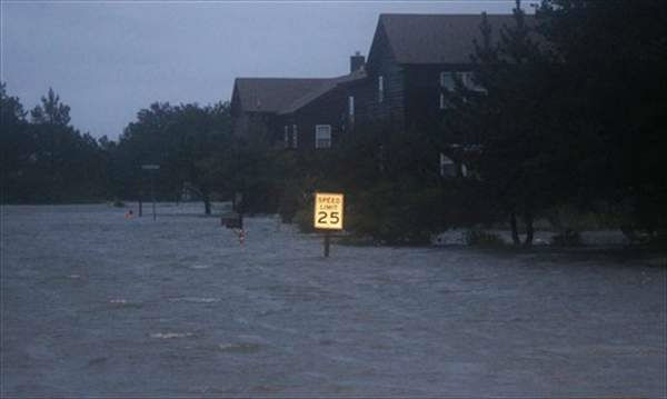 "<div class=""meta ""><span class=""caption-text "">Floodwaters rise at dusk from the Albemarle Sound on the Outer Banks in Nags Head, N.C., Saturday, Aug. 27, 2011 as Hurricane Irene leaves the North Carolina coast.  ((AP Photo/Charles)</span></div>"