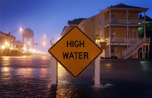 A high water sign is seen partially submerged on a street in Ocean City, Md., Saturday, Aug. 27, 2011, as Hurricane Irene heads toward the Maryland coast. Hurricane Irene knocked out power and piers in North Carolina, clobbered Virginia with wind and churned up the coast Saturday to confront cities more accustomed to snowstorms than tropical storms. <span class=meta>(AP Photo&#47; Patrick Semansky)</span>